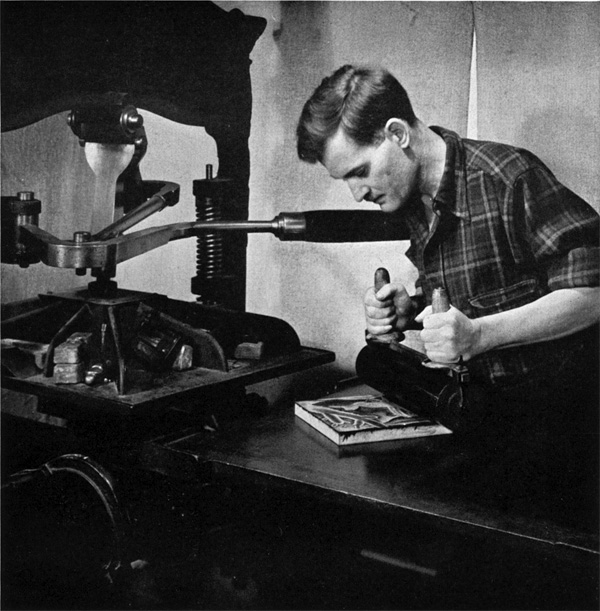 Paul Landacre inking his block