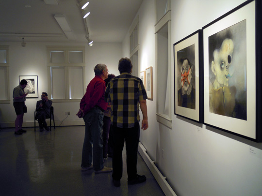 Viewing the artwork with Ilgvars in the background.